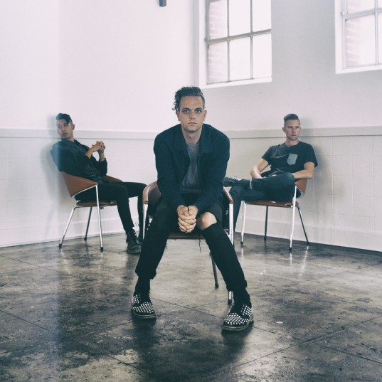 Sir Sly sitting down