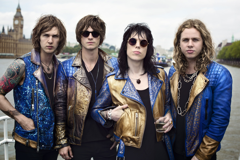 The Struts are (from left to right): drummer Gethin Davies, bassist Jed Elliott, frontman Luke Spiller, and guitarist Adam Slack
