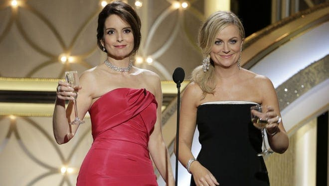 Tina Fey and Amy Poehler, hosts of the 71st Annual Golden Globe Awards Show © Paul Drinkwater, AP